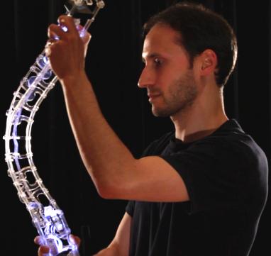 Designer Joseph Malloch holding the Spine digital musical instrument.