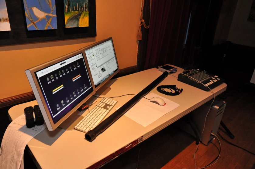 A tenor T-Stick ready for performance; the visible MaxMSP patches perform gesture extraction, mapping, and sound synthesis.