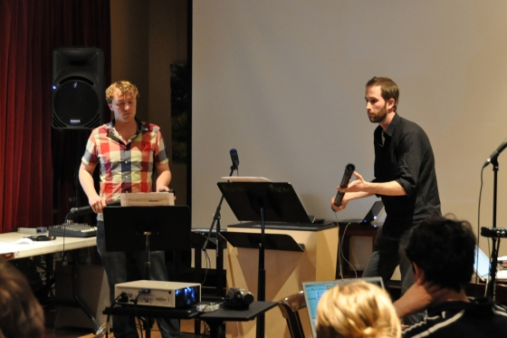 Percussionist Ben Duinker playing tenor T-Stick, and composer Taylor Brook playing soprano T-Stick in a seminar concert at McGill University.