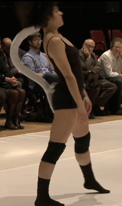 Dancer Sophie Breton wearing a fully-functional foam prototype of the Spine DMI during a public workshop demonstration.