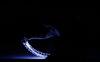 Dancer Sophie Breton with the Spine digital musical instrument during a performance of Les Gestes. Instrument design by Joseph Malloch and Ian Hattwick.