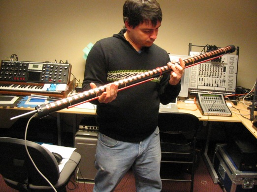 Brazilian percussionist Fernando Rocha investigating the first T-Stick prototype. The T-Stick is a digital musical instrument developed by Joseph Malloch at the Input Devices and Music Interaction Lab, McGill University.
