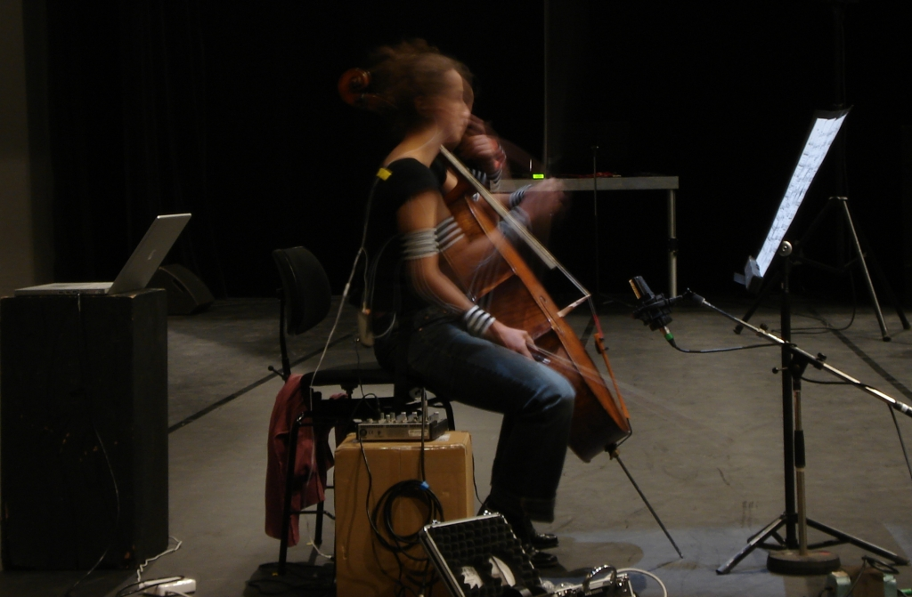 'Cellist Chloé Dominguez rehearsing with motion sensors attached to her arms.