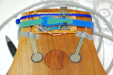 A view of the bottom of the early Hyper-Kalimba, showing FSR sensors placed for idiosyncratic kalimba technique.