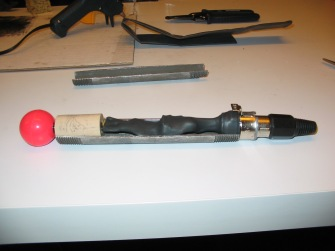 Internal components of the bow are encased in shrink-tubing to prevent contact with the steel case.