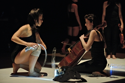 Dancer Soula Trougakos and 'cellist Elinor Frey during a performance of Les Gestes. Instrument design by Joseph Malloch and Ian Hattwick. Photograph by Michael Slobodian. Credit: Van Grimde Corps Secrets / IDMIL / CIRMMT / McGill University.